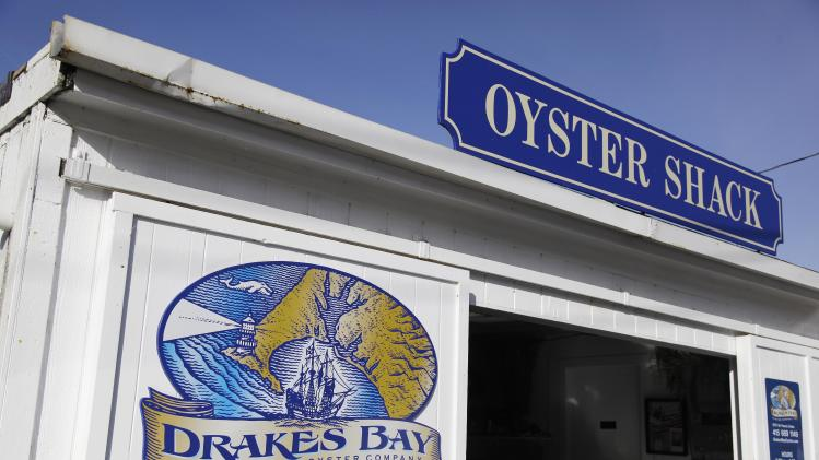 In this photo taken Wednesday Nov. 21, 2012, is the exterior of an oyster shack is shown at the Drakes Bay Oyster Company in Point Reyes National Seashore, Calif. U.S. Interior Secretary Ken Salazar on Thursday, Nov. 29, 2012,  said he will shut down an historic Northern California oyster farm along Point Reyes National Seashore, designating the site as a wilderness area.  Salazar said he will not renew the Drakes Bay Oyster Co. lease that expires Friday. The move will bring a close to a years-long environmental battle over the site. (AP Photo/Eric Risberg)