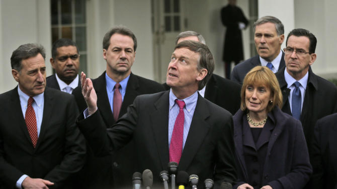 Colorado Gov. John Hickenlooper, center, accompanied by fellow members of the Democratic Governors Associations, looks up to the overcast sky, outside the White House in Washington, Feb. 22, 2013,  following their meeting with President Barack Obama and Vice President Joe Biden. From left are, Vermont Gov. Peter Shumlin, Virgin Island Gov. John de Jongh, Montana Gov. Steve Bullock, Hickenlooper, New Hampshire Gov. Maggie Hassan, Washington Gov. Jay Inslee and Connecticut Gov. Dan Malloy.  (AP Photo/Pablo Martinez Monsivais)