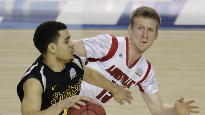 Wichita State's Fred Van Vleet (23) moves the ball as Louisville's Tim Henderson (15) defends during the second half of the NCAA Final Four tournament college basketball semifinal game Saturday, April 6, 2013, in Atlanta. (AP Photo/Chris O'Meara)