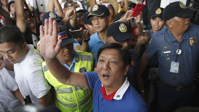 BongBong Marcos waves to supporters at the Commission on Elections in Manila