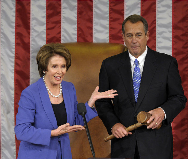 House Minority Leader Nancy Pelosi of Calif. gestures after passing the gavel House Speaker John Boehner of Ohio, who was re-elected as House Speaker of the 113th Congress, Thursday, Jan. 3, 2013, on