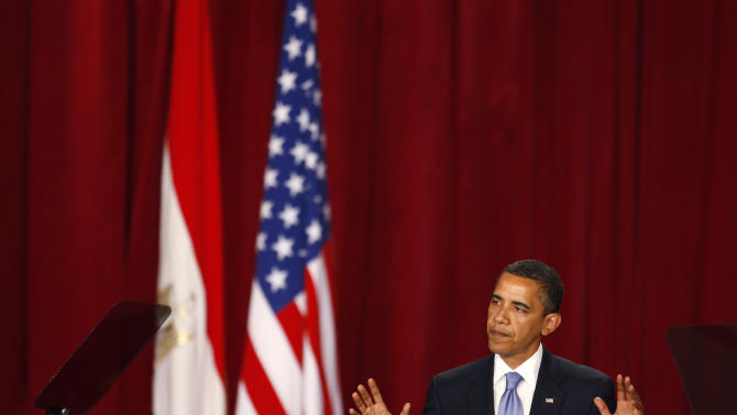 "FILE - In this June 4, 2009 file photo, U.S. President Barack Obama delivers a speech at Cairo University in Cairo, Egypt. In his speech, Obama called for a ""new beginning between the United States and Muslims,"" declaring that ""this cycle of suspicion and discord must end."" Recent images of angry mobs in Arab cities burning American flags and attacking U.S. diplomatic posts suggest the Muslim world is no less enraged at the United States than when President George W. Bush had to duck shoes hurled at him in Baghdad. But more than three years after Obama declared in Cairo that he would seek ""a new beginning"" in U.S.-Muslim relations, a closer look reveals strides as well as setbacks.  (AP Photo/Nasser Nasser, File)"