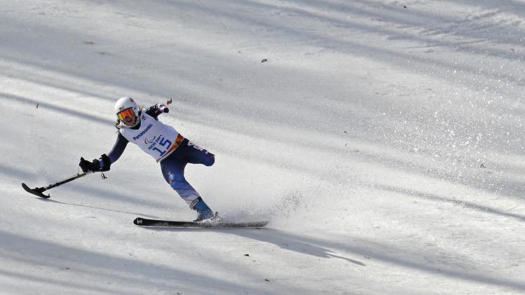 Stephanie Jallen of the U.S. brakes after crossing the finish line during the women's standing skiing Super G at the 2014 Sochi Paralympic Winter Games at the Rosa Khutor Alpine Center