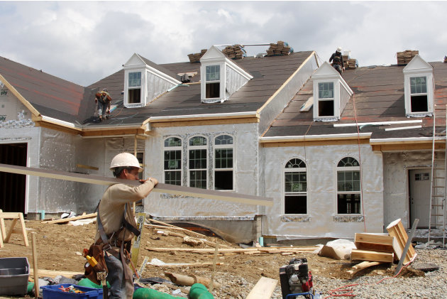 This May 2, 2012, photo, shows a new homes under construction in Bridgeville, Pa. A surge in homebuilding pushed U.S. construction spending up by the largest amount in five months, the latest indicati