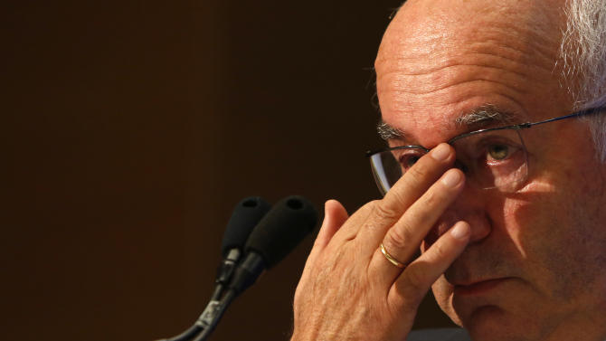 Italian Soccer Federation (FIGC) newly elected president Carlo Tavecchio adjusts his glasses at the end of the national elective assembly at Fiumicino, near Rome, Monday, Aug. 11, 2014. Carlo Tavecchio has been elected the new president of the Italian football federation, replacing Giancarlo Abete. Despite allegations of racism marring his electoral campaign, Tavecchio beat Demetrio Albertini by a majority vote on Monday. (AP Photo/Riccardo De Luca)