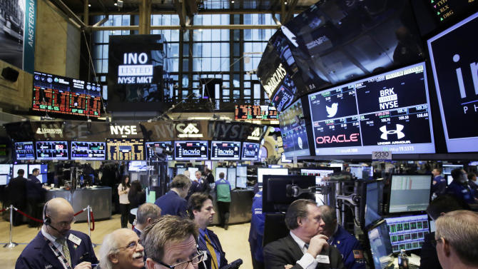 FILE - In this Wednesday, Feb. 12, 2014, file photo, traders monitor stock prices at the New York Stock Exchange. Stocks were mostly higher in midday trading Tuesday, Feb. 18, 2014, as investors returned from a long holiday weekend. (AP Photo/Mark Lennihan)