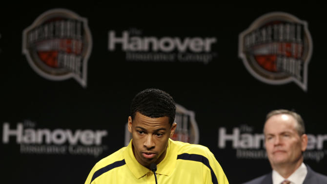 Michigan guard Trey Burke speaks after being presented with the 2013 Bob Cousy Award during the Naismith Memorial Basketball Hall of Fame class announcement, Monday, April 8, 2013, in Atlanta, Georgia. (AP Photo/Charlie Neibergall)