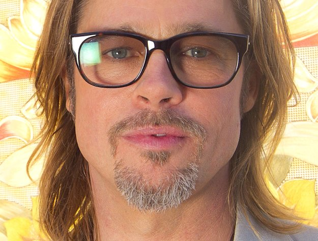 FILE- In this May 23, 2012 file photo, Brad Pitt poses for portraits for the film Killing Them Softly, during the 65th Film Festival in Cannes, France. Pitt is now on China&#39;s version of Twitter, and his mysterious first tweet has drawn thousands of comments. The actor&#39;s verified Sina Weibo account sent the message Monday, Jan. 7, 2013: &quot;It is the truth. Yup, I&#39;m coming.&quot; That was forwarded more than 31,000 times and netted over 14,000 comments, many expressing surprise. He gathered more than 100,000 followers. (AP Photo/Joel Ryan, File)