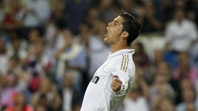 Real Madrid's Cristiano Ronaldo from Portugal celebrates his goal during the Spanish La Liga soccer match against Rayo Vallecano at the Santiago Bernabeu stadium in Madrid, Spain, Saturday, Sept. 24, 2011. (AP Photo/Andres Kudacki)