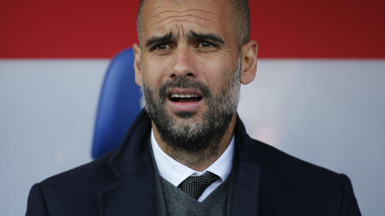 Bayern Munich's coach Guardiola reacts prior to Bundesliga soccer match against Eintracht Braunschweig in Berlin