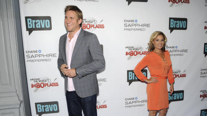 "Hosts Cat Cora, left, and Curtis Stone attend the ""Around the World in 80 Plates"" Finale Sneak Peek Party presented by Chase Sapphire Preferred and Bravo on Thursday, July 12, 2012 in New York, NY.  (Photo by Evan Agostini/Invision for Chase Sapphire Preferred/AP Images)"