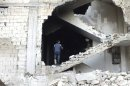 A man is seen on a damaged staircase in Homs