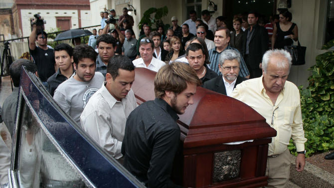 Chilean Consul in Venezuela, Fernando Berendique, right front, helps to carry the coffin with the remains of his 19-year-old daughter Karen to a waiting hearse, in Maracaibo, Venezuela, Saturday March 17, 2012.  Berendique said his daughter was shot early Saturday, while riding in a vehicle with her brother and another young man, when the trio ignored a command to stop by police at a checkpoint, fearing the officers might be robbers. The Prosecutor General's Office says in a statement that 11 police officers are under investigation for their roles in the death. Berendique's daughter is reported to have died after suffering three bullet wounds. (AP Photo/Fabiola Portillo)