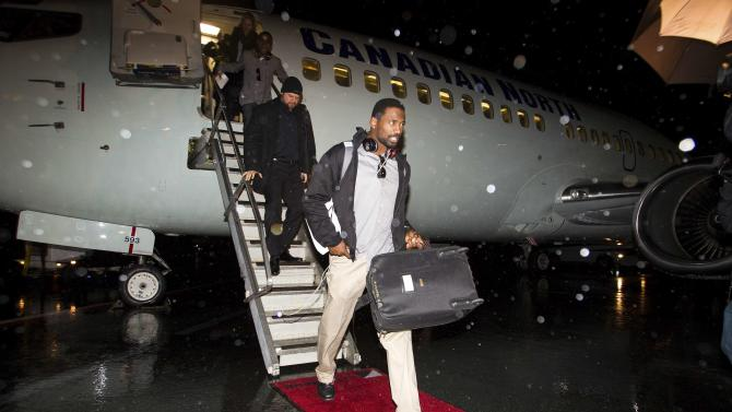 Brandon Stewart of the Hamilton Tiger-Cats arrives at the Vancouver International Airport prior to the 102nd Grey Cup game in Vancouver