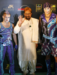 FILE - In this June 11, 2009, file photo, Bollywood star Rajesh Khanna poses before a circus show at the 10th International Indian Film Academy in Macau. Media reports say Khanna, the first Hindi film actor to gain superstar status in Indian films, died Wednesday, July 18, 2012, after a brief illness. He was 69. (AP Photo/Vincent Yu, File)
