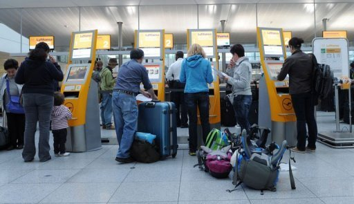 "<p>Flight passengers use the Lufthansa self-check-in desks at the ""Franz-Josef-Strauss"" airport in Munich, southern Germany, on early September 5, 2012. A 24-hour cabin crew strike has grounded half of Lufthansa's flights on Friday, a spokesman for the top German carrier said.</p>"