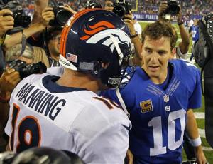 Broncos' Peyton Manning talks with his brother, Giants' Eli Manning after the Broncos defeated the Giants in their NFL football game in East Rutherford