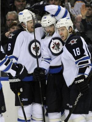 Pavelec stops 29 in Jets' 2-1 win over Sabres
