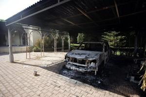 A burnt vehicle inside the US consulate compound in Benghazi