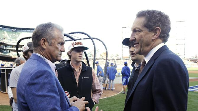 Former Kansas City Royals George Brett, left, speaks to Chief Executive Officer of the San Francisco Giants' Larry Bear before Game 3 of baseball's World Series between the Kansas City Royals and the San Francisco Giants Friday, Oct. 24, 2014, in San Francisco. (AP Photo/Jeff Chiu)