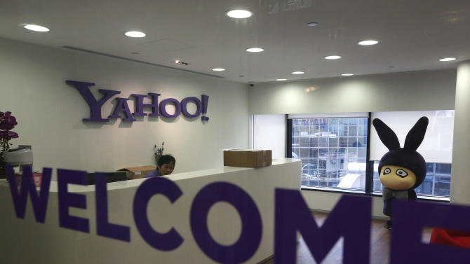 The logo of Yahoo is seen in its Hong Kong office in Hong Kong Monday, May 21, 2012. Struggling Internet company Yahoo Inc. has secured a lifeline after agreeing to sell half of its prized stake in Chinese e-commerce group Alibaba for about $7.1 billion, with most of the cash going to shareholders. (AP Photo/Vincent Yu)