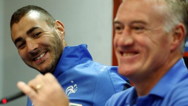 France's Karim Benzema (L) and coach Didier Deschamps smile at the start of their news conference at Vicente Calderon stadium in Madrid
