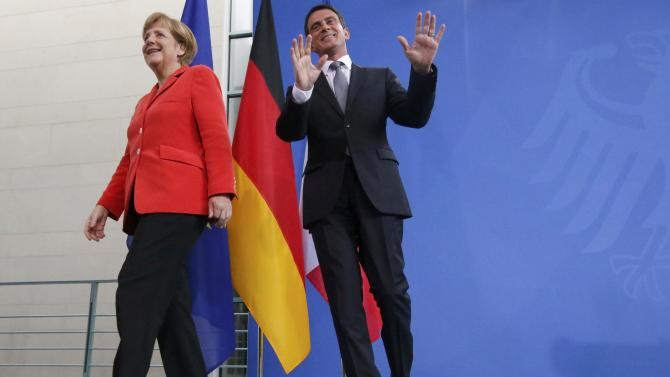 German Chancellor Merkel and French Prime Minister Valls leave after news conference following talks in Berlin