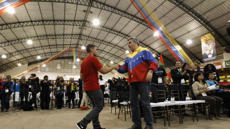 Cuban Elian Gonzalez greets Venezuelan Yul Jabour during the Youth Leftists Festival in Quito