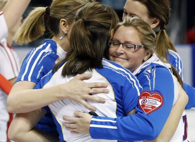 British Columbia skip Scott hugs her teammates after they defeated Team Canada during their bronze medal game at the Scotties Tournament of Hearts curling championship in Kingston