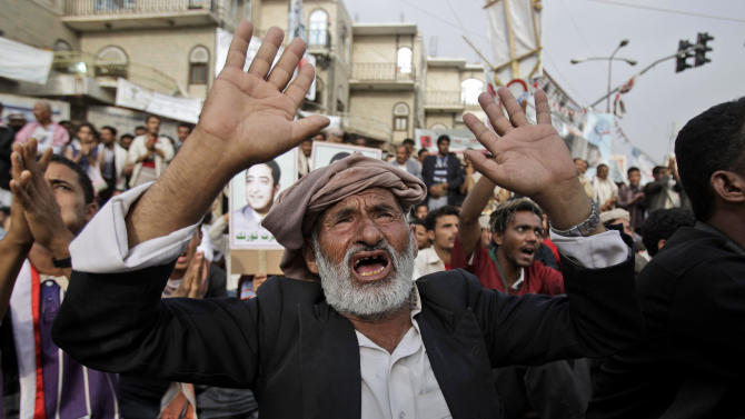 An elderly anti-government protestor, reacts during a demonstration demanding the resignation of Yemeni President Ali Abdullah Saleh, in Sanaa, Yemen, Thursday, June 30, 2011. Yemen's president, hospitalized in Saudi Arabia after an attack nearly a month ago on his palace, has instructed his deputy to hold talks with political opponents on a deal to transfer power and end the nation's spiraling political crisis, his foreign minister said Wednesday. (AP Photo/Hani Mohammed)