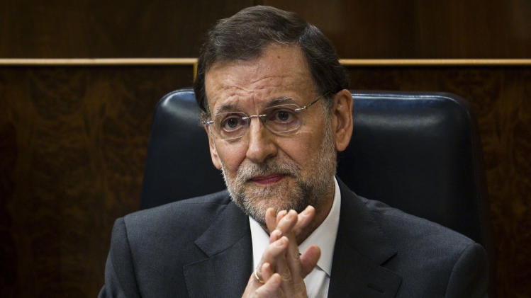 Spain's Prime Minister Mariano Rajoy attends a control session at the Spanish Parliament, in Madrid, Wednesday, June 13, 2012. The interest rate Spain would have to pay to raise money on the world's bond markets continued to rise Wednesday amid worries that a planned bank bailout might not be enough to save the country from needing an overall financial rescue. (AP Photo/Daniel Ochoa de Olza)