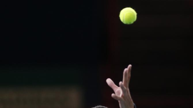 Tsonga of France serves the ball during his men's singles tennis match against Nishikori of Japan in the third round of the Paris Masters tennis tournament at the Bercy sports hall in Paris