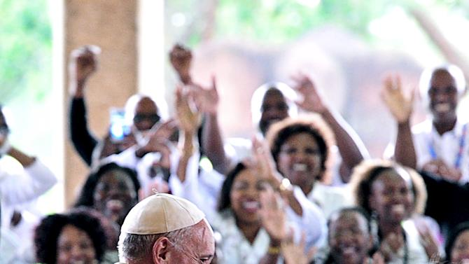 People cheer as Pope Francis arrives at the United Nations office on the first leg of a landmark trip to Africa in Nairobi