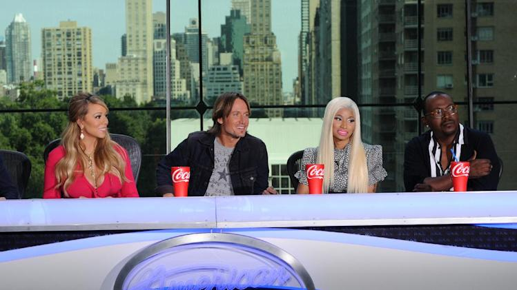"This image released by Fox shows the new judges for the singing competition series, ""American Idol,"" from left, Mariah Carey, Keith Urban, Nicki Minaj and Randy Jackson during a news conference in New York on Monday Sept. 17, 2012. (AP Photo/FOX, Michael Becker)"