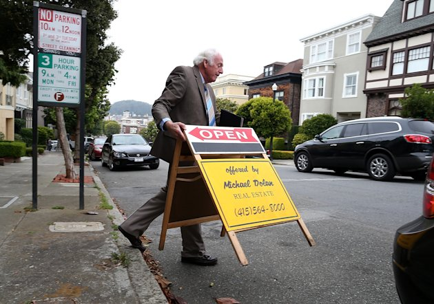 SAN FRANCISCO, CA - JULY 30: Real estate agent Maurice Dolan places an open house sign in front of a home for sale on July 30, 2013 in San Francisco, California. According to the S&P/Case Shiller composite index survey of 20 metropolitan areas, home prices increased 2.4 percent in May, their highest level since 2006. San Francisco home prices skyrocketed 24.5 percent. (Photo by Justin Sullivan/Getty Images)