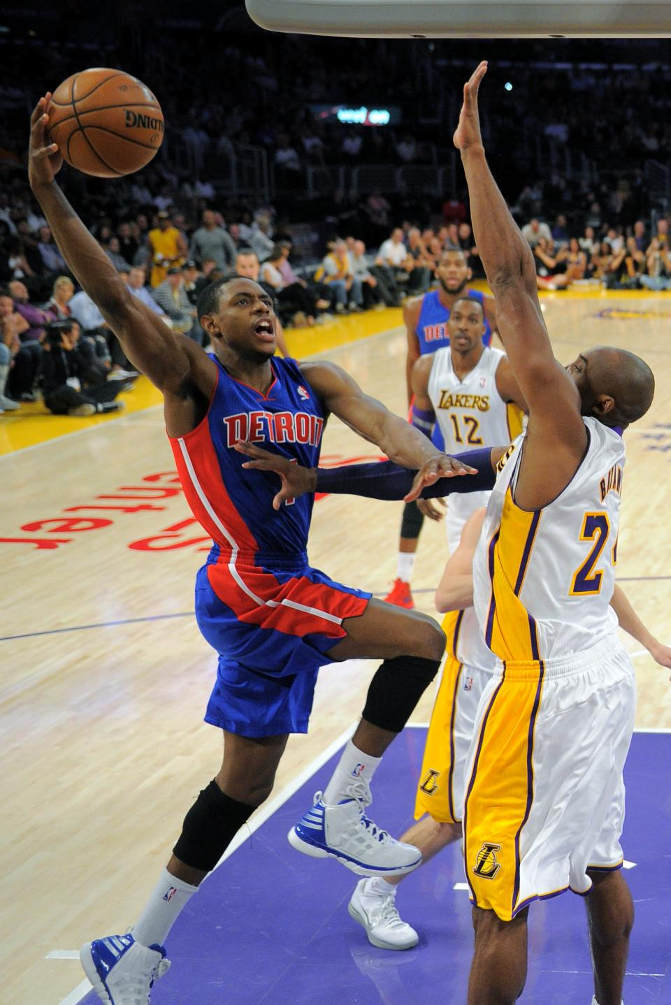 Detroit Pistons guard Brandon Knight, left, puts up a shot as Los Angeles Lakers guard Kobe Bryant defends during the first half of their NBA basketball game, Sunday, Nov. 4, 2012, in Los Angeles. (AP Photo/Mark J. Terrill)