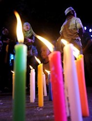 Filipino Muslims light candles during a peace rally to show their support for the framework peace agreement near the Malacanang Palace in Manila. The biggest Muslim rebel group in the Philippines is set to sign a landmark peace plan with the government on Monday aimed at ending a decades-long insurgency in which 150,000 people have died