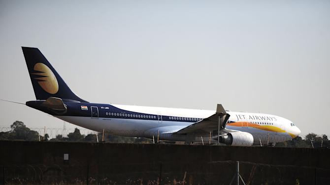 In this photo taken Thursday, May 2, 2013, a plan prepares to take-off from the Waterkloof Air Force Base near Pretoria, South Africa, after being embroiled in a scandal about landing a wedding party at the military base. The South African government says five high-ranking officials have been suspended after this charter plane carrying some 200 guests from India to a family wedding, was allowed to land at the air force base on Tuesday May 1.  The jet landed Tuesday allegedly bypassing customs procedures and angering many South Africans who see the scandal as a case of cronyism linking big business and government and igniting accusations that security laws were breached. (AP Photo)