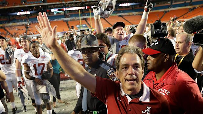 Alabama head coach Nick Saban waves to fans after the BCS National Championship college football game against Notre Dame Monday, Jan. 7, 2013, in Miami. Alabama won 42-14. (AP Photo/David J. Phillip)