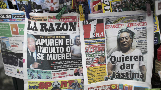 """In this Oct. 14, 2012 photo, the front page of a newspaper shows a photograph of Peru's former President Alberto Fujimori laying in a bed as he serves jail time that reads in Spanish """"They want you to feel sorry for him"""" in Lima, Peru.  A campaign is in full swing to win a pardon for Fujimori from the 25-year prison sentence he is serving for death squad killings and corruption during his 1990-2000 rule. (AP Photo/Rodrigo Abd)"""