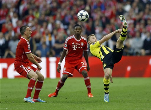 Bayern's Franck Ribery of France, left, vies for the ball with Dortmund's Marco Reus, during the Champions League Final soccer match between  Borussia Dortmund and Bayern Munich at Wembley Stadium in