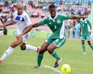 Nigerian defender Elderson Echiejile (R) fights for the ball with a Rwandan player during a 2013 African Cup of Nations qualification match in Calabar. Nigeria advanced to the next round of the 2013 Africa Cup of Nations after they defeated Rwanda 2-0 on aggregate