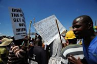 Striking miners stage a protest at the AngloGold Ashanti mine in Carletonville, 84 kms northwest of Johannesburg