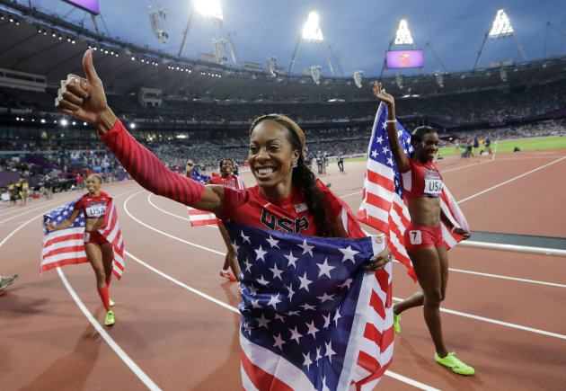 United States&#39; Deedee Trotter, right, United States&#39; Sanya Richards-Ross, front center and United States&#39; Allyson Felix, back left, celebrate winning gold in the women&#39;s 4x400-meter relay final during the athletics in the Olympic Stadium at the 2012 Summer Olympics, London, Saturday, Aug. 11, 2012. (AP Photo/David J. Phillip )