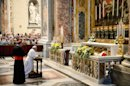Pope Francis prays in front of the tomb of John XXIII in St Peter's Basilica on June 3, 2013 at The Vatican