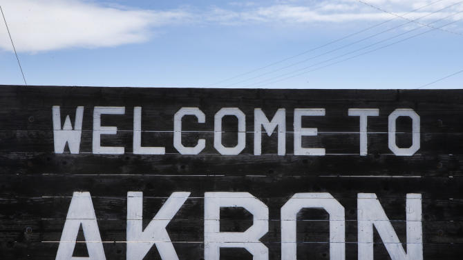 In this Nov. 6, 2013 photo, a sign welcomes visitors to the rural town of Akron, the county seat of Washington County, Colo. A day earlier, a majority in Washington and four other counties on Colorado's Eastern Plains voted yes on the creation of a 51st state, largely over residents' alienation from voters statewide on issues such as civil unions for gay couples, new renewable energy standards, and limits on ammunition magazines. (AP Photo/Brennan Linsley)