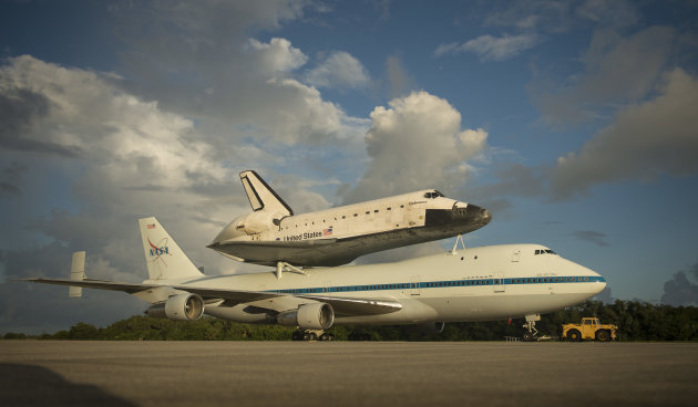This photo provided by NASA shows space shuttle Endeavour atop NASA&#39;s Shuttle Carrier Aircraft, or SCA, at the Shuttle Landing Facility at NASA&#39;s Kennedy Space Center on Monday, Sept. 17, 2012 in Cape Canaveral, Fla. The beginning of Endeavour&#39;s final flight to California has been postponed because of weather along the flight route. NASA had planned for the 747 carrying the shuttle to take off from Kennedy Space Center on Monday. (AP Photo/NASA, Bill Ingalls)