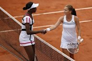 Poland's Agnieszka Radwanska (R) shakes hands with American Venus Williams after she won their French Open match at the Roland Garros stadium in Paris. Radwanska won 6-2, 6-3