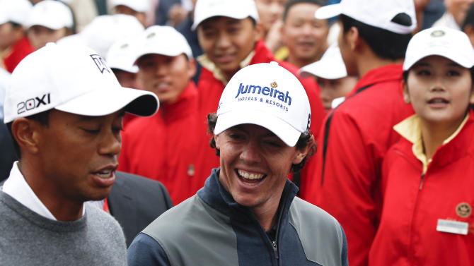Tiger Woods of the United States, left, and Rory McIlroy of Northern Ireland chat on their way to the tee-off on the first hole during their 18-hole medal-match at the Lake Jinsha Golf Club in Zhengzhou, in central China's Henan province, Monday, Oct. 29, 2012. McIlroy shot a 5-under 67 to beat Woods by one stroke in a head-to-head, 18-hole exhibition match between the world's two top-ranked golfers. (AP Photo/Alexander F. Yuan)