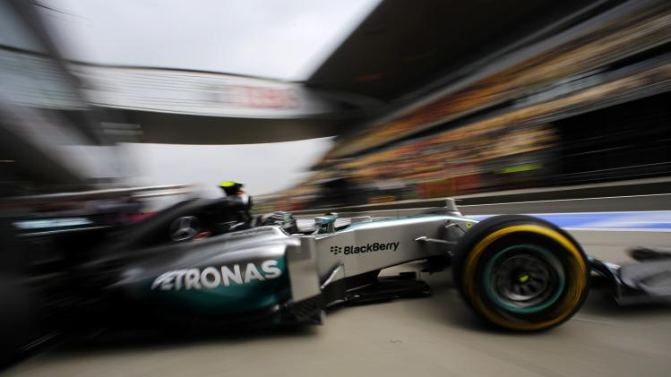 Mercedes Formula One driver Rosberg of Germany drives out of the team garage during the second practice session of the Chinese F1 Grand Prix at the Shanghai International circuit